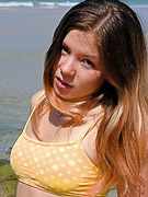 Emily 18 : Emily posing at the beach in a yellow bikini