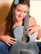 Britney Lightspeed : Gorgeous brunette, Britney Lightspeed, gets distracted from guitar practice!