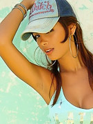 Karla Spice : Karla sports a denim skirt and a hat and takes it off