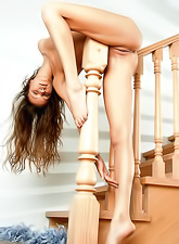 Natasha S takes her clothes off on the stairs and shows her fantastic tight ass.