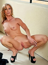 Dee Dee takes her sexy mini skirt off and then fingers her shaved wet meat hole
