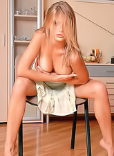 Vika R strips her clothes off in the kitchen and then fingers her trimmed fanny.