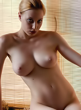 Jamie Narkiss takes her clothes in front of the camera and shows her big breasts.