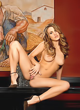 Hot naked Andie Valentino shows how flexible she is as she poses on a table.