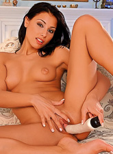 Anetta Keys spreads her sexy legs on the bed and toys her shaved meat hole wildly