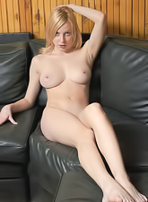 Jamie Narkiss takes her clothes off on the sofa and shows her hungry vagina.