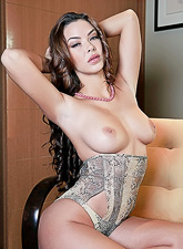 Sophia Santi takes her classy lingerie off and shows us her perfect round boobs.