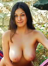 Femjoy Sofie takes her clothes off outdoors in the woods and shows her wet cunt.