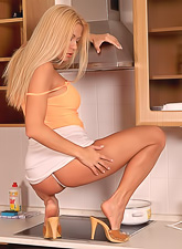Divine Adriana Malkova masturbates with a wooden spoon while cooking a breakfast.
