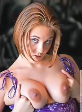 Violet FTV takes her purple dress off and shows us her amazing round breasts.