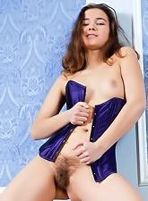 Francine A strips her sexy purple tight corset and then shows us her hairy bush.