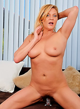 Ginger Lynn takes her sexy black lingerie off and shows us her perky breasts