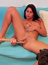 Zafira slowly removes her pink lingerie off and pokes her cunt with a big hard dildo