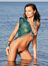 Atena A strips her lingerie out on the beach and shows us her perfect boobs.