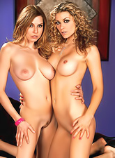 Jamie Lynn and Heather Vandeven spend time playing with each other on a black couch