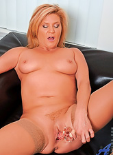 Ginger Lynn takes her little panties off and masturbates in nylon stockings