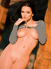 Katie Fey takes her black thongs off outdoors and shows us her big breasts.