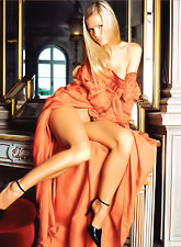 Alluring blonde model Diana strips her orange dress and shows her amazing body.
