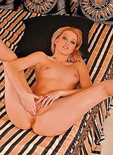 Sophie Moone takes her all of her clothes off and wildly fingers her wet meat hole
