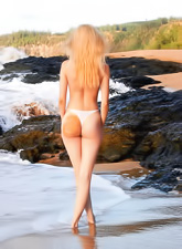 Jane A takes her white lingerie outdoors by the sea and shows her amazing ass.