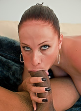 Gianna Michaels takes her clothes off on the sofa and sucks huge black boner.
