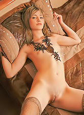 Irina L slowly strips in front of the camera and shows us her hungry trimmed cunt.