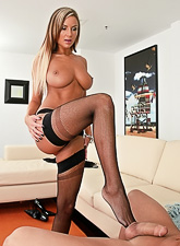 Amy Reid teases us in sexy black nylon stockings as she gives a foot job to her lover
