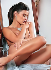 Atena A strips her sexy blue see through lingerie off and shows her round breasts.