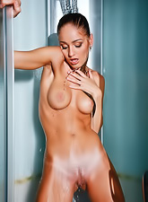 Veronika F strips her white shirt off and exposes her fantastic round breasts.