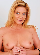 Ginger Lynn takes her sexy blue dress off and masturbates in sexy nylon stockings
