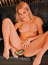 Sophie Moone spreads her sexy legs on the sofa and toys her hungry shaved muff