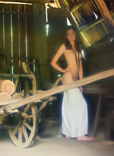 Katya B takes her sexy white dress off in the barn and shows us her amazing ass.
