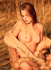 Andrea C takes her fur coat off outdoors and shows us her fantastic teen body.