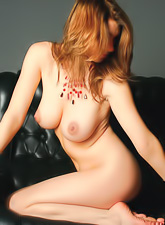 Maria D takes her sexy lingerie off on the sofa and shows us her big round jugs.