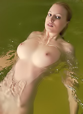 Jamie Narkiss takes her clothes off in the pool and shows us her big hooters.
