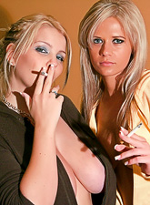 Ann Angel takes all of her clothes and makes out with her blonde lesbo lover