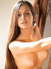Ennie A slowly strips on the bed and teases us with her fantastic tight ass.