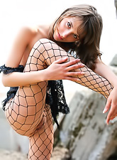 Inna C takes her sexy black lace lingerie off and teases us in black pantyhose.