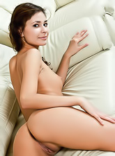 Irina J takes her sexy brown lingerie on the sofa and shows us her amazing ass.