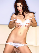 Foxy brunette chick Sarah Blake strips her white thongs and shows her fresh cunt.