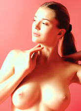 Vika R takes her cute pink lingerie off and shows us her perky round breasts.